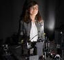 Assistant Professor Marissa Weichman with an ultrafast laser system, which was recently installed in her lab.