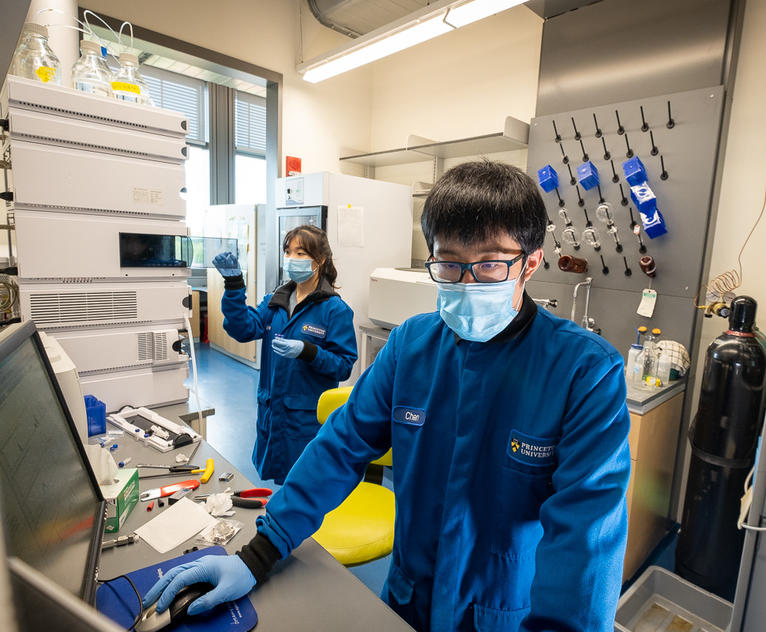 Esther Han and Chen Zhang in the Seyedsayamdost lab loading and analyzing samples in a time-of-flight mass spectrometry instrument.